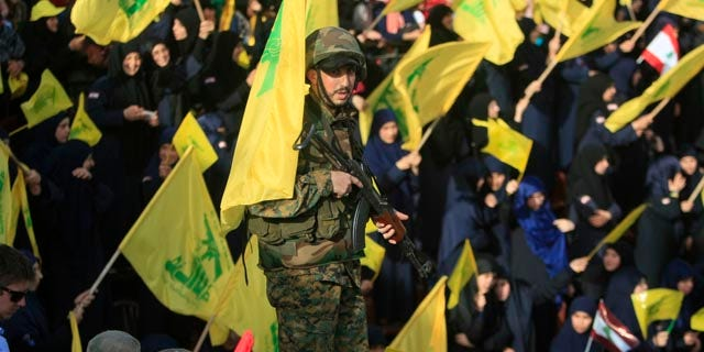 May 24, 2015: A Hezbollah fighter stands guard during a rally commemorating 'Liberation Day,' which marks the withdrawal of the Israeli army from southern Lebanon in 2000, in the town of Nabatiyeh, Lebanon. (AP Photo/Mohammed Zaatari)