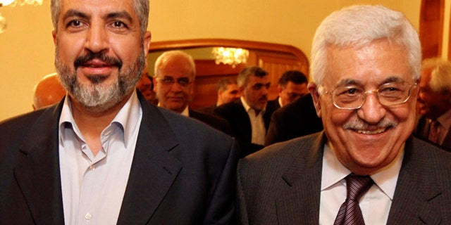 Nov. 24, 2011: Palestinian Hamas leader Khaled Mashaal, left, and Palestinian President Mahmoud Abbas are seen together during their meeting in Cairo, Egypt. (AP/Office of Khaled Meshaal, File)