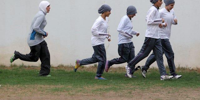 In this May 21, 2012 file photo, members of a Saudi female soccer team practice at a secret location in Riyadh, Saudi Arabia.