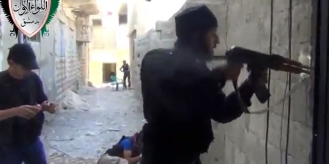 Friday, May 3, 2013 - Image taken from video obtained from the Ugarit News shows Syrian rebels clashing with government forces in Damascus, Syria.