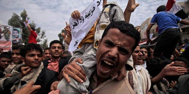 March 13, 2011: An anti-government protestor shouts during a demonstration demanding the resignation of Yemeni President Ali Abdullah Saleh, in Sanaa, Yemen.
