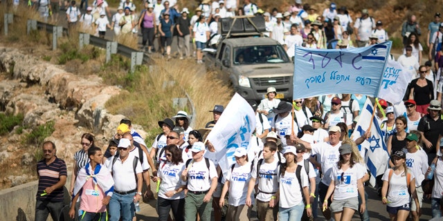 June 27: Family members of Israeli captured soldier Sgt. Gilad Schalit and their supporters march near Schalit's home in Mitzpe Hila, northern Israel. (AP)