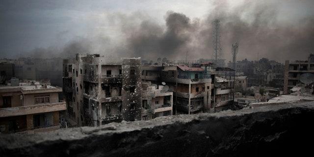 Oct. 2, 2012: Smoke rises over Saif Al Dawla district, in Aleppo, Syria.