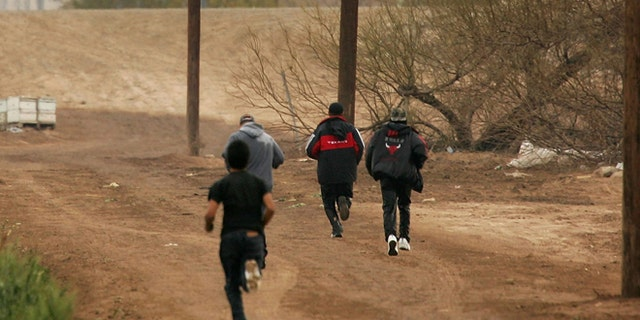 YUMA, AZ - MARCH 16:  Men run after crossing illegally into the U.S. from Mexico on March 16, 2006 at the border town of near San Luis, south of Yuma, Arizona. As Congress begins a new battle over immigration policy, U.S. Customs and Border Protection (CBP) border patrol agents in Arizona are struggling to control undocumented immigrants that were pushed into the region by the 1990's border crack-down in California called Operation Gatekeeper. A recent study by the Pew Hispanic Center, using Census Bureau data, estimates that the U.S. currently has an illegal immigrant population of 11.5 million to 12 million, about one-third of them arriving within the past 10 years. More than half are reportedly from Mexico. Ironically, beefed-up border patrols and increased security are reportedly having the unintended result of deterring many from returning to their country of origin.  (Photo by David McNew/Getty Images)