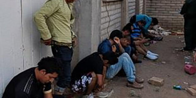 Ten Mexican nationals - nine males and one female - were found living inside the feces-infested and waste-strewn home