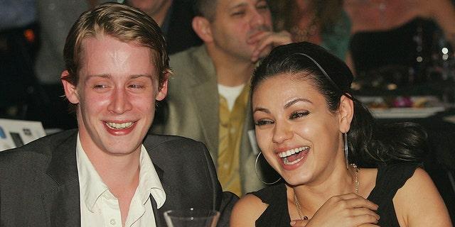 Mila Kunis and Macaulay Culkin in 2005.