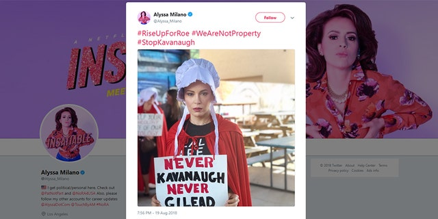 """Actress Alyssa Milano dressed up as a character from """"The Handmaid's Tale"""" to protest Trump's Supreme Court nominee Brett Kavanaugh."""