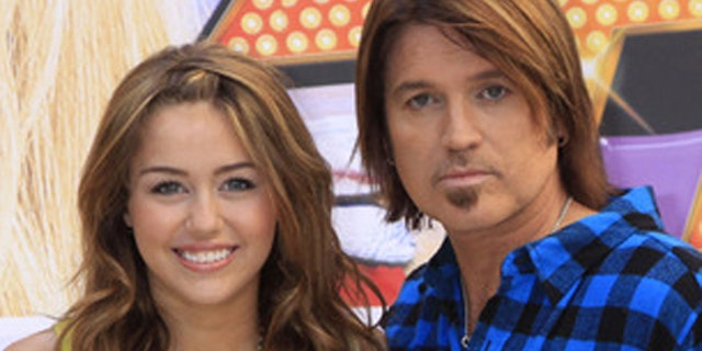 """April 21, 2009: Miley Cyrus and her dad Billy Ray Cyrus their movie, """"Hannah Montana: The Movie"""" in Madrid."""