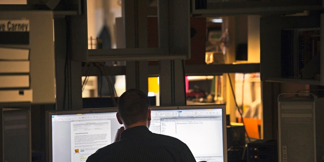 Aug. 11, 2011: A computer forensic examiner looks for evidence on hard drives at the Department of Defense Cyber Crime Center in Linthicum, Md.