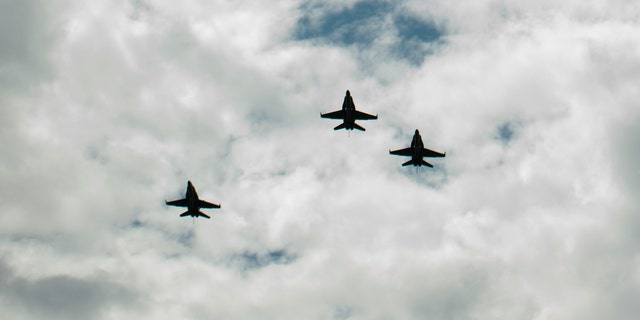 """CINCINNATI, OH - AUGUST 31:  In this handout photo provided by NASA, U.S. Navy F/A-18 jets from Strike Fighter Squadron (VFA) 106 and Strike Fighter Squadron (VFA) 34, from Naval Air Station Oceana (Va.) fly in a """"Missing Man"""" formation over the Camargo Club following a memorial service celebrating the life of Neil Armstrong on August 31, 2012 in Cincinnati, Ohio. Armstrong, the first man to walk on the moon during the 1969 Apollo 11 mission, died Saturday, August 25. He was 82. (Photo by Bill Ingalls/NASA via Getty Images)"""
