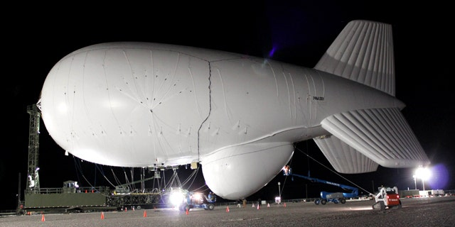 A 233-foot-long dirigible being inflated in Utah at the U.S. Air Force's Utah Test and Training Range about 80 miles west of Salt Lake City. Two of the high-tech dirigibles -- which are designed to detect cruise missiles and other near-ground tests -- were launched over Utah on Wednesday April 14, 2010 for the first in a series of tests planned in the state.