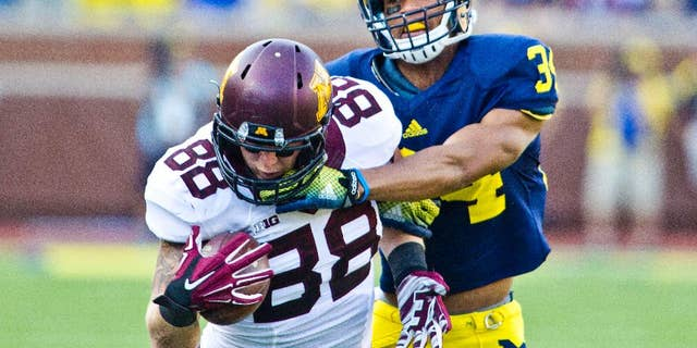 Minnesota tight end Maxx Williams (88) makes a one-handed catch while defended by Michigan defensive back Jeremy Clark (34) in the third quarter of an NCAA college football game in Ann Arbor, Mich., Saturday, Sept. 27, 2014. Minnesota won 30-14. (AP Photo/Tony Ding)