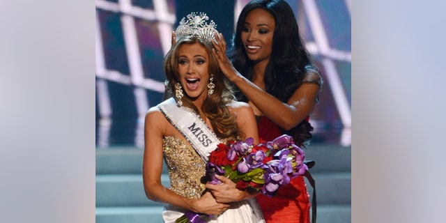 June 16, 2013. Miss Connecticut Erin Brady is crowned the winner of the Miss USA 2013 pageant by Nana Meriwether in Las Vegas. Brady, of South Glastonbury, Conn., relinquishes her crown Sunday, June 8, 2014, when the 2014 pageant competition being held in Baton Rouge, La., selects a new Miss USA.