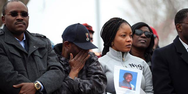 FILE- In this March 23, 2015, file photo, Barway Collins' father, Pierre Collins, wipes away tears as he stands with his wife, Yamah, and supporters at vigil in Crystal, Minn. for their missing son. A body found in the Mississippi River over the weekend has been identified as that of the 10-year-old Minnesota boy, Barway Collins, who has been missing for nearly a month, the police said Sunday, April 12, 2015. (AP Photo/The Star Tribune, Jeff Wheeler, File)