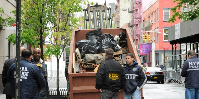 April 23: The last dumpster with material from the basement of 127 Prince Street is removed from the scene in New York. Authorities say no obvious signs of human remains have been found in a Manhattan basement being searched in connection with the 1979 disappearance of 6-year-old Etan Patz.