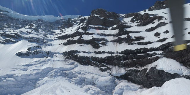 May 31, 2014: This photo provided by the National Parks Service, shows the Liberty Ridge Area of Mount Rainier as viewed from the Carbon Glacier. (AP Photo/National Park Service)