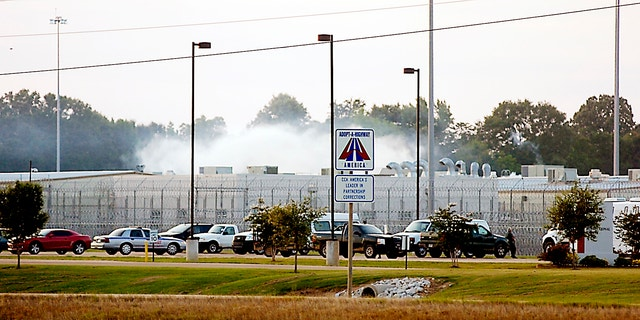 May 20, 2012: Smoke rises above the Adams County Correctional Center in Natchez, Miss.