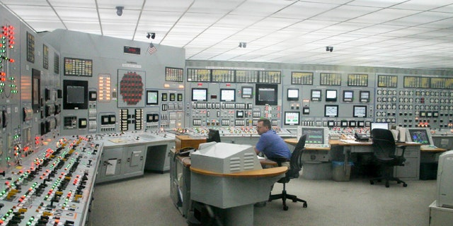 June 26: A worker monitors the control room of Nebraska Public Power District's Cooper nuclear power plant near Brownville, Neb.