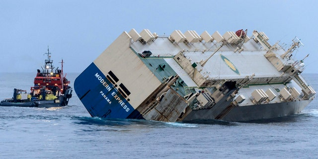 The car carrier Modern Express, seen here listing badly as it is being towed off the French coast, is not slated for demolition - yet.