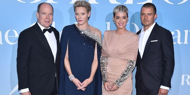 (L-R) Prince Albert II of Monaco, Princess Charlene of Monaco, Katy Perry and Orlando Bloom attend the Monte-Carlo Gala for the Global Ocean 2018 on September 26, 2018 in Monte-Carlo, Monaco.