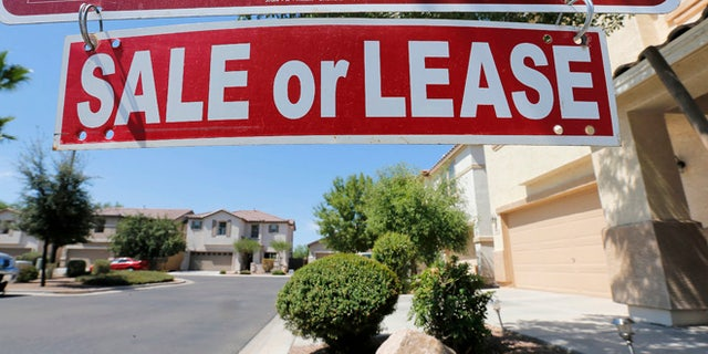 FILE -- July 30, 2013: A home is seen for sale  in Gilbert, Ariz.