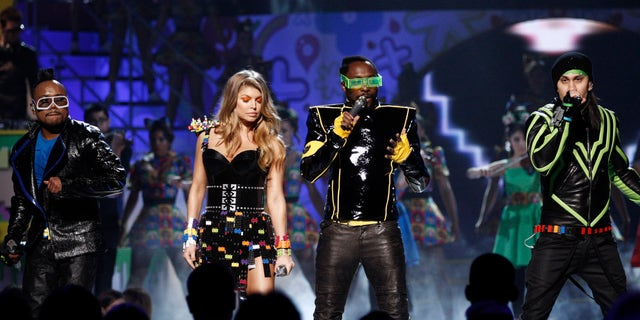 """FILE - In this April 2, 2011 file photo, The Black Eyed Peas perform at Nickelodeon's 24th Annual Kids' Choice Awards in Los Angeles. Black Eyed Peas are reuniting after a five-year hiatus for a new rendition of their song """"Where Is The Love?"""" aimed at ending gun violence. (AP Photo/Matt Sayles, File)"""