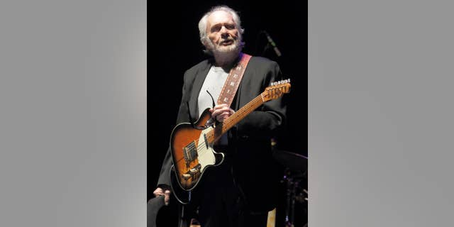 In this May 3, 2014 file photo, Merle Haggard performs in concert at Harrah's Resort in Atlantic City, N.J. At 77, he still tours around the country about two weeks each month and recently bought a new tour bus, a sign that he's not interested in retirement from the road.