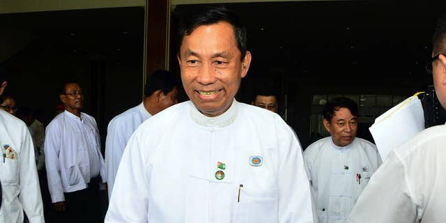 In this  Wednesday, Aug 12, 2015, photo, Myanmar's Parliament speaker Shwe Mann leaves after a press conference at the Union Solidarity and Development Party headquarters in Naypyitaw, Myanmar. Security forces have seized control of the headquarters of Myanmar's ruling party as rifts between party members intensified ahead of upcoming general elections, witnesses said Thursday. (AP Photo/Aung Shine Oo)