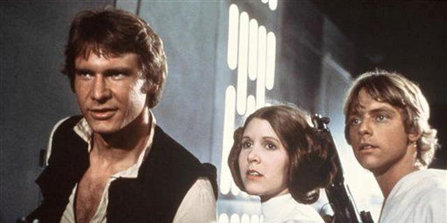 "From left to right: Harrison Ford, Carrie Fisher and Mark Hamill in ""Star Wars."""