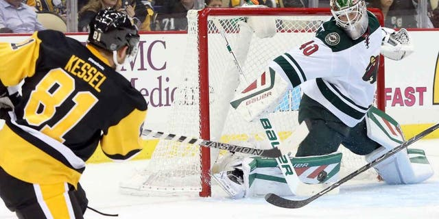 Tuesday, Nov. 17: Minnesota Wild goalie Devan Dubnyk makes a save against Pittsburgh Penguins right wing Phil Kessel during the second period at the CONSOL Energy Center in Pittsburgh, Penn.