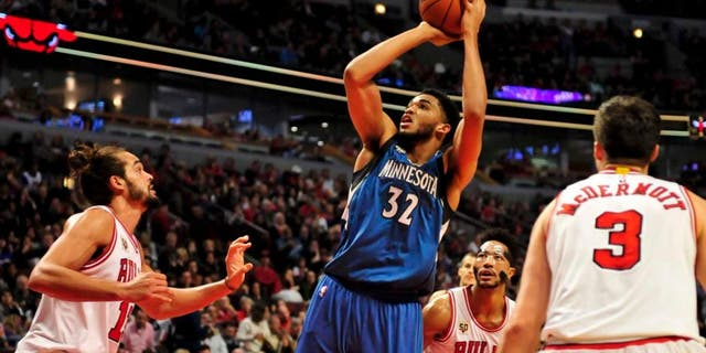 Saturday, Nov. 7: Minnesota Timberwolves center Karl-Anthony Towns shoots over Chicago Bulls center Joakim Noah during the second half at the United Center. Minnesota won 102-93 in overtime.