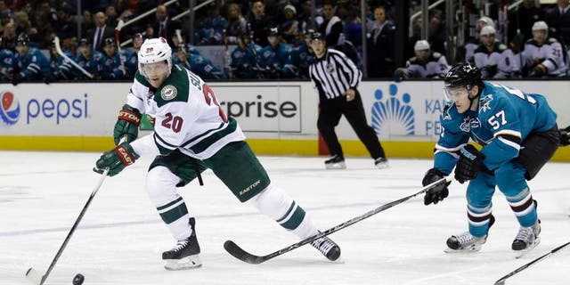 Saturday, Dec. 12: The Minnesota Wild's Ryan Suter skates past the San Jose Sharks' Tommy Wingels during the second period of the Wild's 2-0 win in San Jose, Calif.
