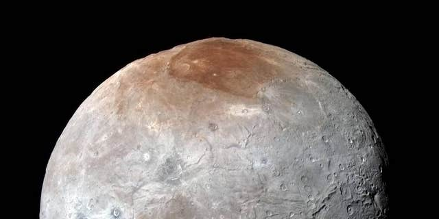 Charon in Enhanced Color - NASA's New Horizons captured this high-resolution enhanced color view of Charon just before closest approach on July 14, 2015.