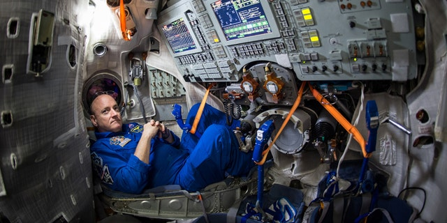 NASA astronaut Scott Kelly is seen inside a Soyuz simulator at the Gagarin Cosmonaut Training Center (GCTC), Wednesday, March 4, 2015 in Star City, Russia.