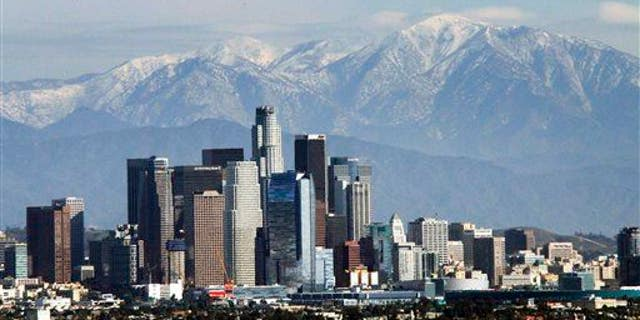 The snow-capped San Gabriel Mountains provide a backdrop to the downtown Los Angeles skyline as seen from Kenneth Hahn State Recreation Area in Baldwin Hills, Wednesday, Dec. 31, 2014.