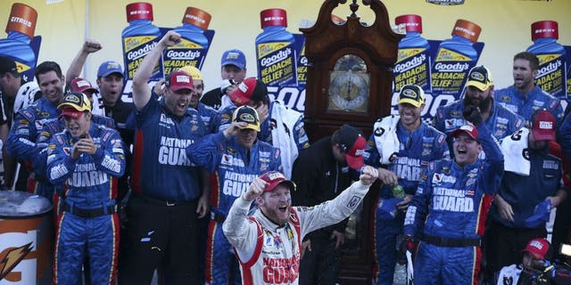 Dale Earnhardt Jr., driver of the #88 National Guard Chevrolet, celebrates in victory lane after winning during the NASCAR Sprint Cup Series Goody's Headache Relief Shot 500 at Martinsville Speedway on October 26, 2014 in Martinsville, Virginia.