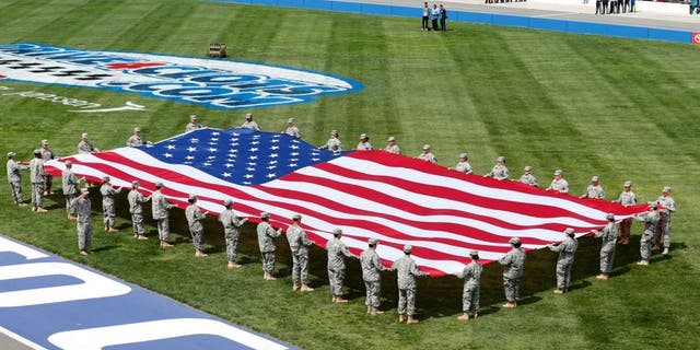 FONTANA, CA - MARCH 22: A view of the American flag during the National Anthem prior to the NASCAR Sprint Cup Series Auto Club 400 at Auto Club Speedway on March 22, 2015 in Fontana, California. (Photo by Todd Warshaw/NASCAR via Getty Images)