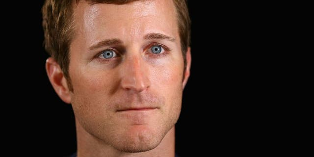 CHARLOTTE, NC - OCTOBER 01: Driver Kasey Kahne speaks to the media during a press conference for the NASCAR Sprint Cup Series Contender 12 at NASCAR Hall of Fame on October 1, 2014 in Charlotte, North Carolina. (Photo by Streeter Lecka/NASCAR via Getty Images)