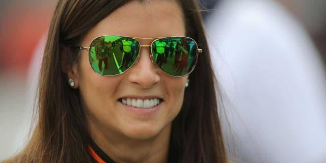 INDIANAPOLIS, IN - JULY 25: Danica Patrick, driver of the #10 GoDaddy Chevrolet, stands on the grid during qualifying for the NASCAR Sprint Cup Series Crown Royal Presents the Jeff Kyle 400 at the Brickyard at Indianapolis Motor Speedway on July 25, 2015 in Indianapolis, Indiana. (Photo by Jerry Markland/Getty Images)