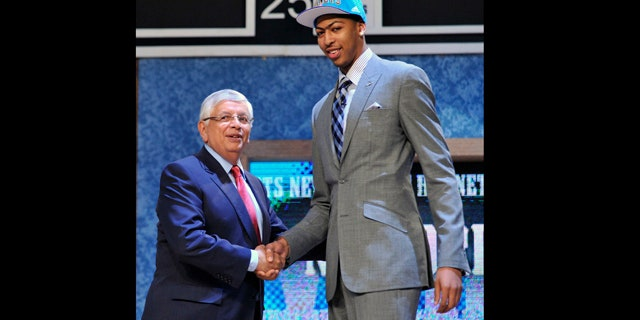 June 28, 2012: NBA Commissioner David Stern, left, poses with the No. 1 overall draft pick Anthony Davis, of Kentucky, who was selected by the New Orleans Hornets in the NBA basketball draft in Newark, N.J.
