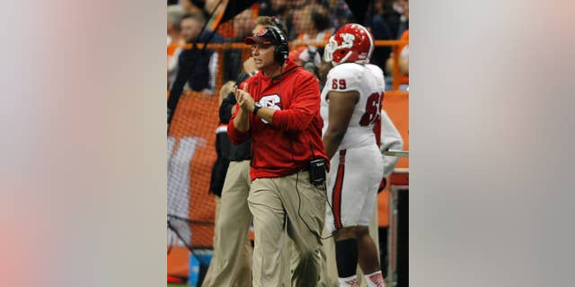 North Carolina State's head coach Dave Doeren calls out to his players in the third quarter of an NCAA college football game against Syracuse in Syracuse, N.Y., Saturday, Nov. 1, 2014. North Carolina State won 24-17. (AP Photo/Nick Lisi)