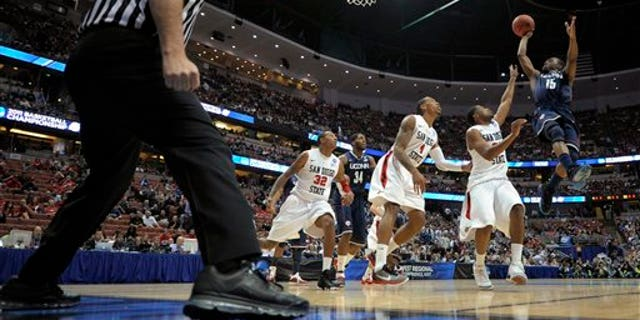 March 24: Connecticut's Kemba Walker (15) shoots over San Diego State's Chase Tapley, Malcolm Thomas (4), Billy White (32) during the first half of a West regional semifinal in the NCAA college basketball tournament in Anaheim, Calif. (AP)
