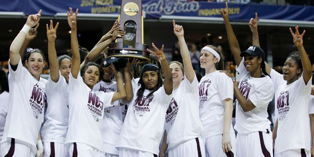 April 5: Texas A&M players celebrate with the trophy after their 76-70 win over Notre Dame in the women's NCAA Final Four college basketball championship game in Indianapolis.