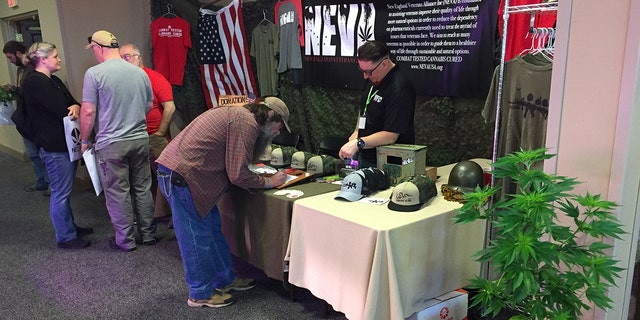 Derek Cloutier (right), president and founder of the New England Veterans Alliance, meets with other veterans at the NECANN cannabis & hemp convention in Burlington, Vermont. Cloutier organized and will be speaking at a Memorial Day rally in Washington, D.C., to promote veterans' access to legal marijuana.
