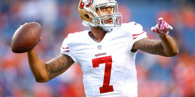 Oct 19, 2014; Denver, CO, USA; San Francisco 49ers quarterback Colin Kaepernick (7) prior to the game against the Denver Broncos at Sports Authority Field at Mile High. Mandatory Credit: Chris Humphreys-USA TODAY Sports