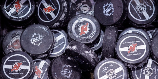 May 15, 2012: In this file photo, ice covered hockey pucks are shown at the New Jersey Devils practice rink in Newark, N.J.