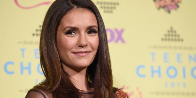 """""""Vampire Diaries"""" actress Nina Dobrev attends the Teen Choice Awards in 2015. (Photo by Chris Pizzello/Invision/AP)"""
