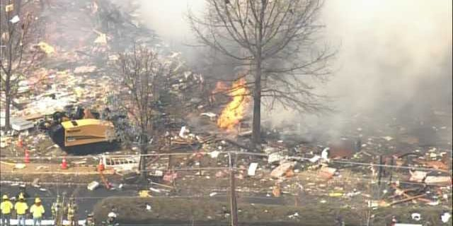 """March 4, 2014: This aerial photo shows the aftermath of an explosion at a townhouse complex in Ewing, N.J. A gas line damaged by a contractor exploded """"like a bomb"""" while utility crews worked to repair it Tuesday at the complex, killing one woman and injuring seven people while several homes were destroyed or damaged. (MyFoxPhilly.com)"""