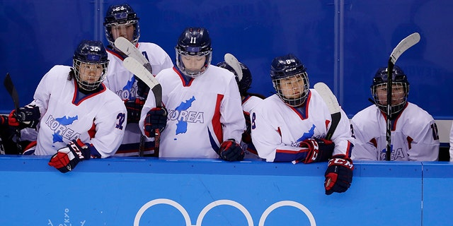North Korea's Jin Ok (32), of the combined Koreas team, joins teammates Park Yoonjung (23), Park Ye-eun (11), Kim Selin (8), and Kim Heewon (12) during the third period of the classification round of the women's hockey game at the 2018 Winter Olympics in Gangneung, South Korea, Sunday, Feb. 18, 2018. Switzerland won 2-0.