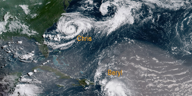 Tropical Storm Chris is seen off the coast of the Carolina's while the remnants of former Hurricane Beryl swirl in the Caribbean Sea, as Saharan dust wraps around the storm on July 9, 2018.